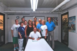 "Polk County Judge Brandon Ellison signs the proclamation declaring July 28 as ""Clarice's Room of Hope Day""."