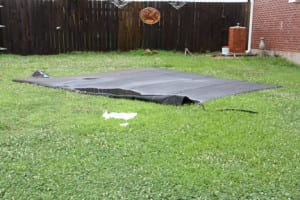 Roofing material blown off of the Long residence on Tuesday, July 8, 2014.