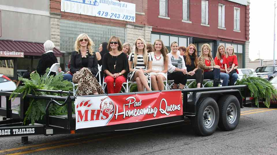 Preserving Bearcat heritage, the Bearcat Foundation, Inc.'s float was 16 former Mena Homecoming Queens.