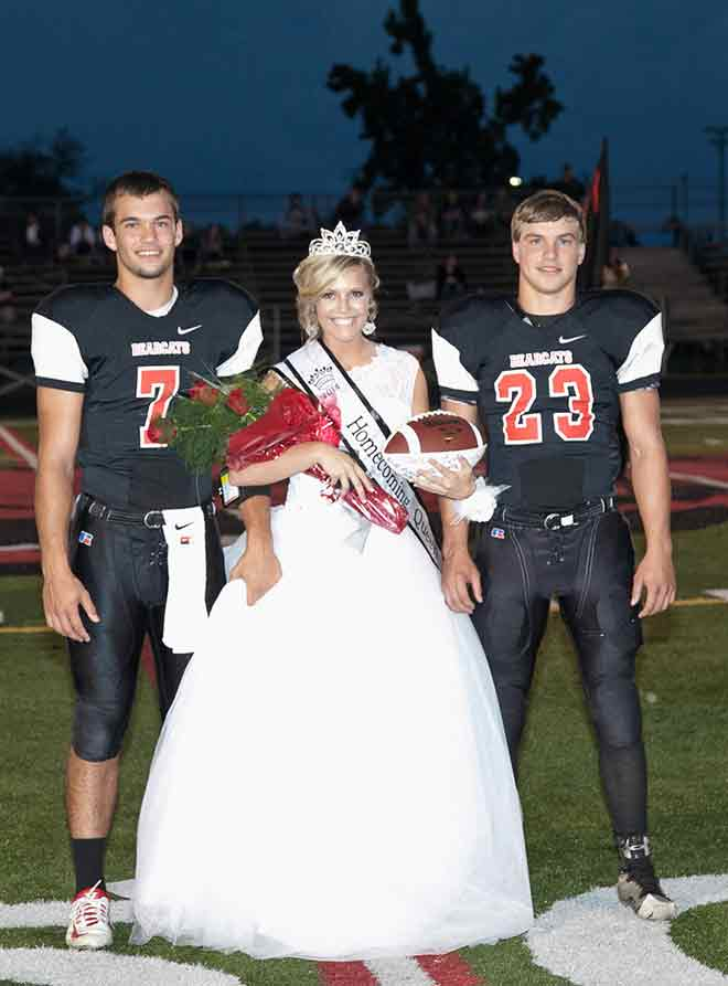 Senior maid, Jami Miller escorted by Senior Bearcats Sage Kesterson and Greg Craig [PHOTO BY MICHAEL CATE]