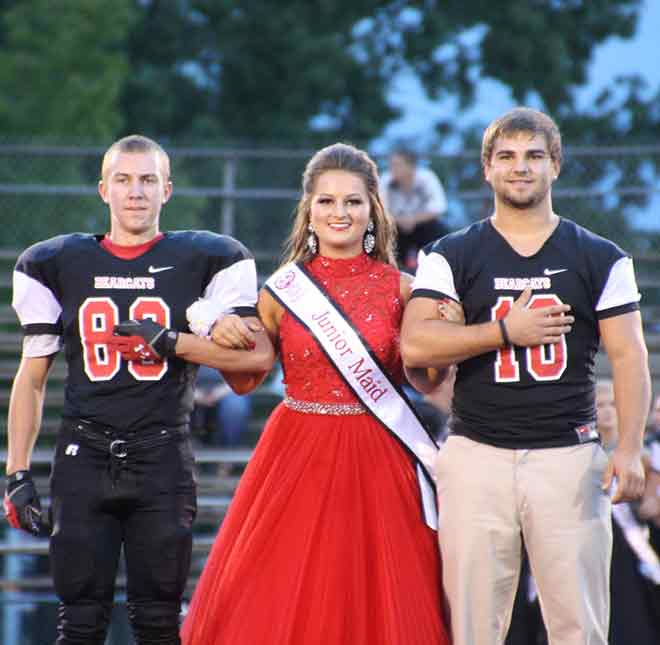Junior maid Keeley Jones escorted by Senior Bearcats Kelly Miller and Nick Holmes.