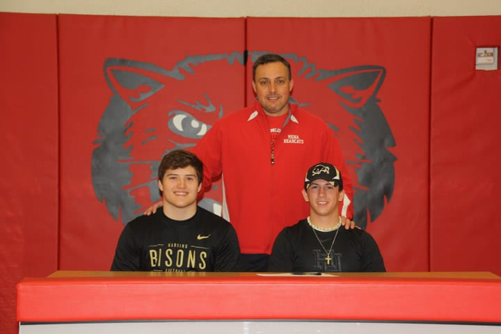 Bearcats Luke Bowser and Jackson Daugherty will continue to be teammates as they have both signed letters of intent with Harding University. They are shown with Bearcat Head Coach Tim Harper.