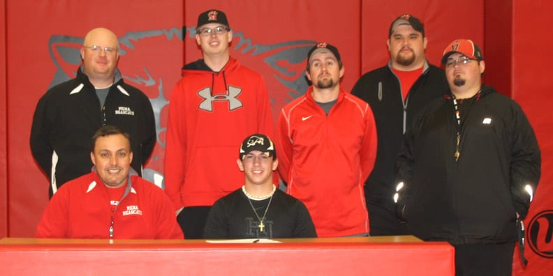 Jackson Daugherty shown with Bearcat coaching staff.